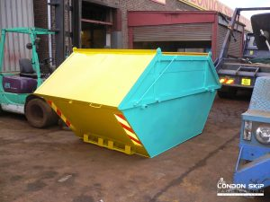 Yellow and cyan enclosed skip