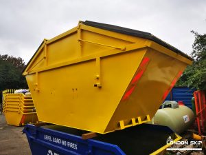 Yellow enclosed skip