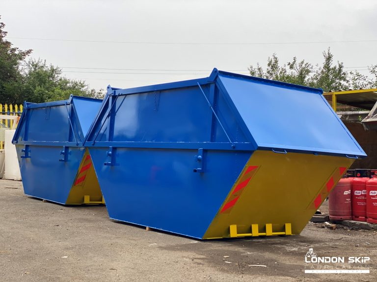 Yellow and blue enclosed skips